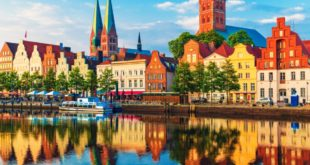 Scenic summer sunset view of the Old Town pier architecture in Lubeck, Germany
